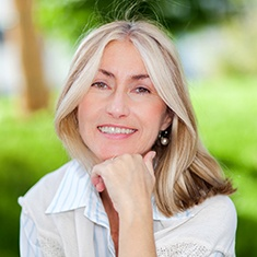 Woman with dental implants in Arlington Heights.