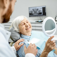Older women with dental implants.
