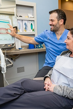 Arlington Heights dentist talking to patient about cosmetic dentistry