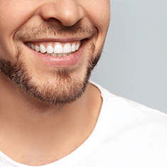 A man's beautiful smile after getting cosmetic dentistry in Arlington Heights