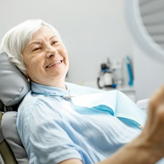 Woman smiling in the dental chair