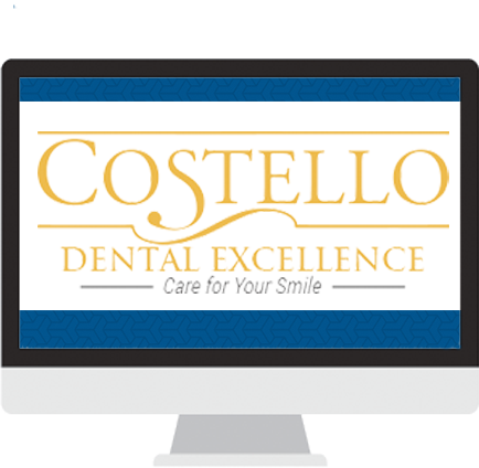 Computer with Costello Dental Excellence on screen