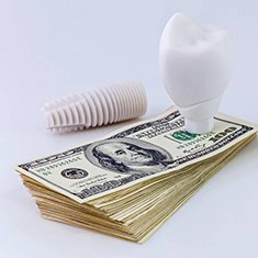 Cost of dental implants in Arlington Heights represented by model implant and money