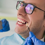 Man smiles as he gets dental implants in Arlington Heights