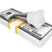Model implant and money representing cost of dental implants in Arlington Heights
