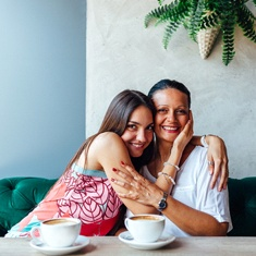 adult daughter hugging her mom after implant denture placement