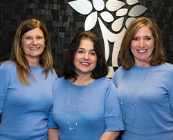 Front dental office ladies smiling