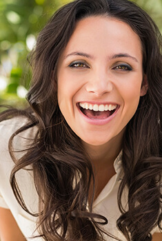Arlington Heights Cosmetic Dentist Lady smiling merrily