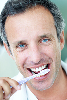 Arlington Heights Preventive Dentistry Man brushing teeth