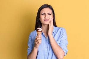woman with sensitive teeth eating ice cream