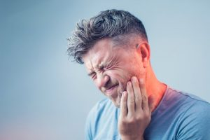 man with toothache who needs emergency dentist