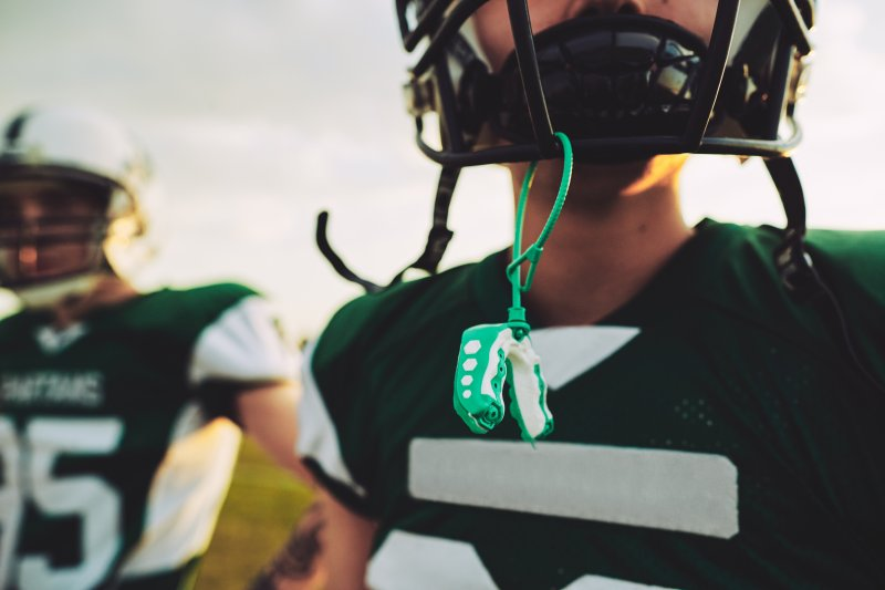 Closeup of athlete in football gear